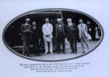 Grove Park Inn -exterior view of men with automobile. Photograph reads: